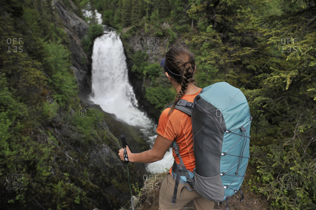 Backpacker hikes the Resurrection Pass Trail in Chugach National Forest, Southcentral, Alaska.