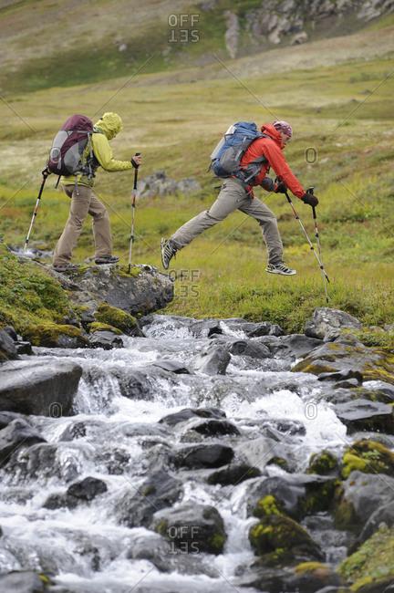 Backpackers hike in Chugach State Park near Anchorage, Alaska.