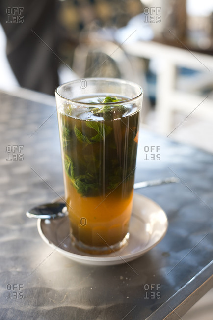 A glass of traditional Moroccan mint tea at a cafe in Asilah, Morocco.