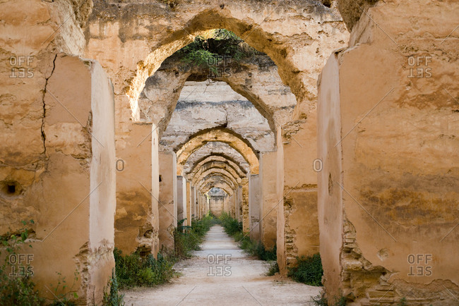 Looking down a series of doorways in the famous Heri Es Souani Granary in Meknes, Morocco.