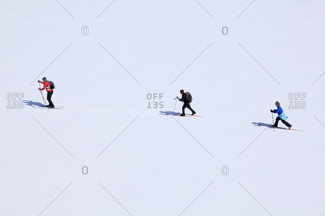 A family of Mom and two young sons crossing Botheration Pond on a cross country ski outing.