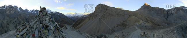 Trekkers ascending Thorung La Pass departing from High Camp at sunrise, along Annapurna Circuit trek, Nepal.