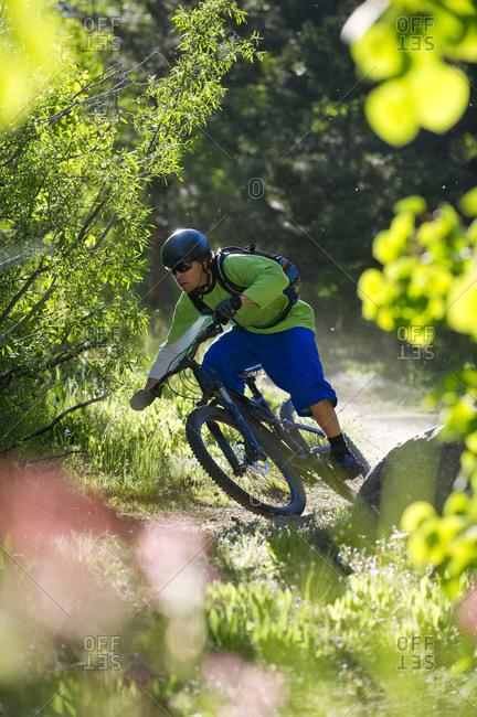 A man, mountain biking on the Scott's Lake trail in South Lake Tahoe, CA.
