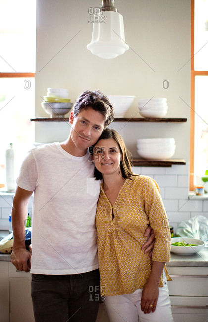 Portrait of wife and husband standing in the kitchen