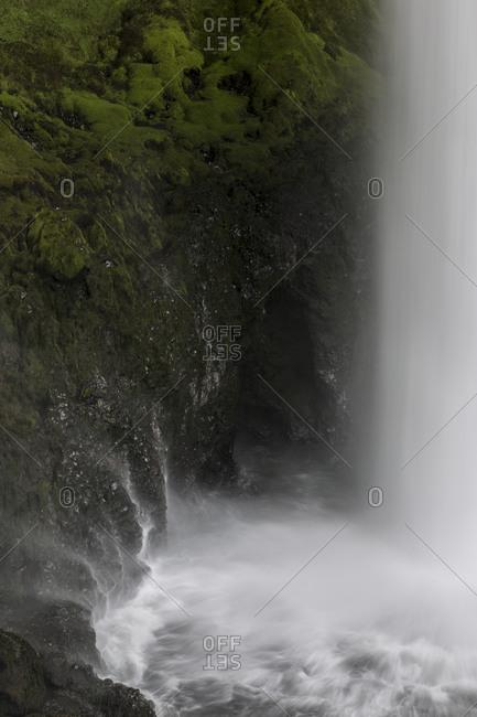 Kvernufoss waterfall splashing into a lake Iceland