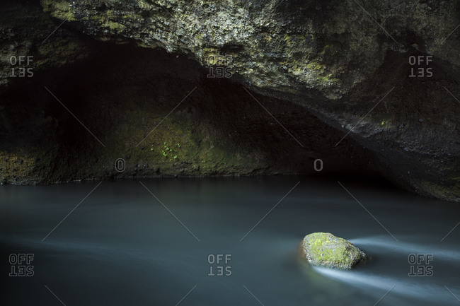 Rock in a cave stream in Iceland