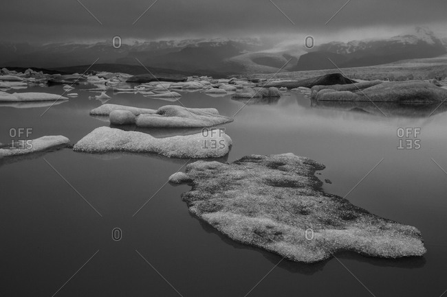 Ice floating in water at Fjallsarlon glacier lagoon in Iceland