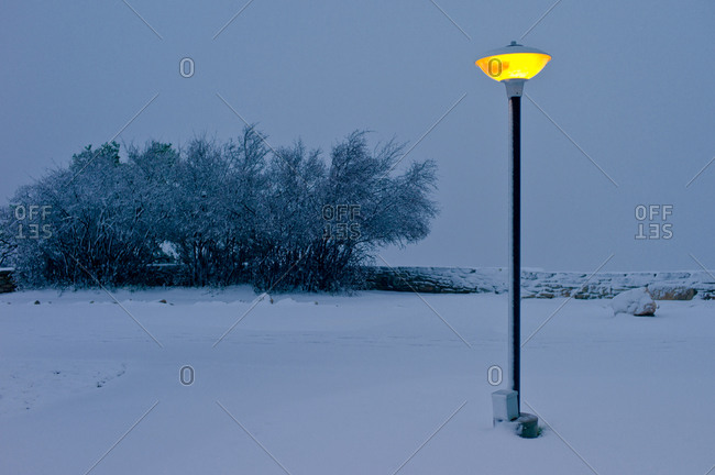 Lamppost in fresh snow at dusk