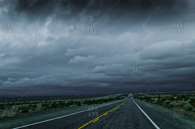 Desert highway with cloudy sky