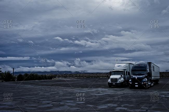 Semi-trailers resting in a truck stop