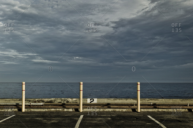 Dramatic clouds above coastal parking lot