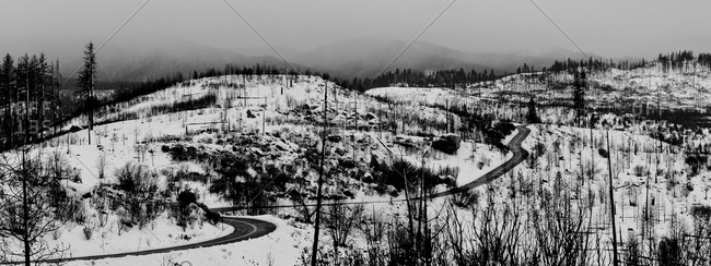 Snowy landscape with winding road on hill