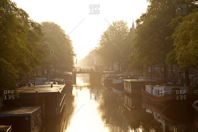 Canal at sunrise in Amsterdam, The Netherlands