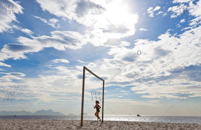 Jogger at Copacabana Beach, Rio de Janeiro, Brazil