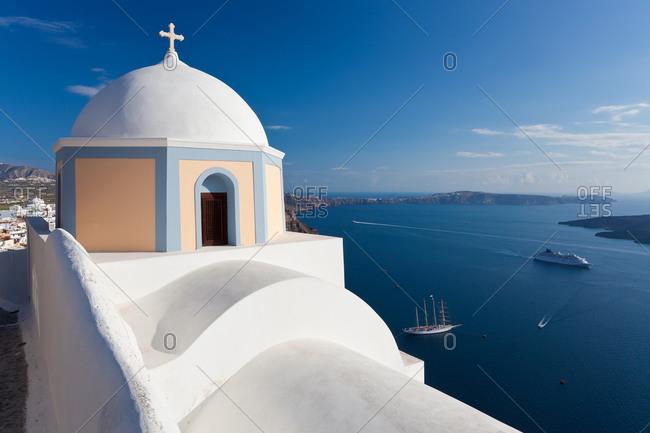 Church and cruise ship in Fira, Santorini, Greece