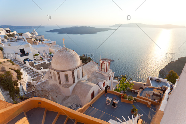View of Fira town at sunset in Santorini, Greece