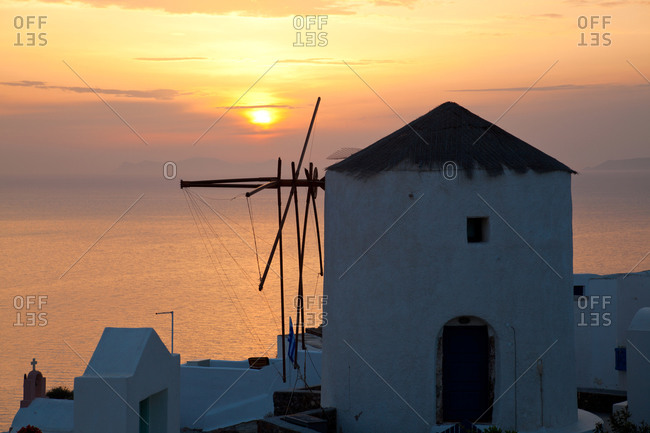 Windmill at sunset in Oia, Santorini, Greece