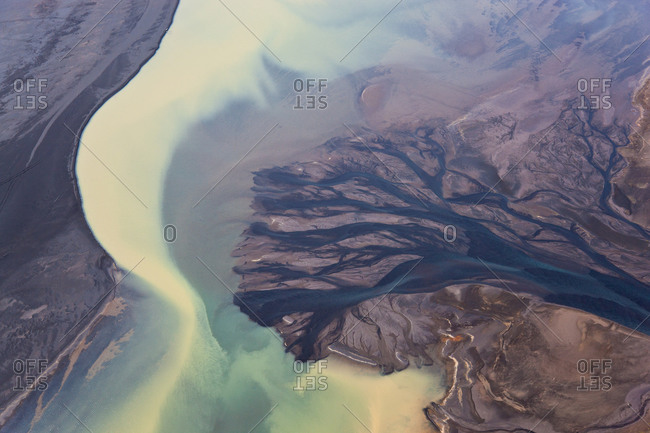 Aerial view of river estuary or delta, colored by glacial melt, Hvammur, Iceland