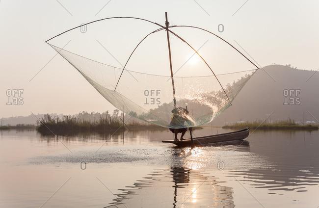 Fisherman fishing on Loktak Lake in Imphal, Manipur, India