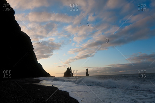 Reynisdrangar rock formations and black beach at Vik, Iceland