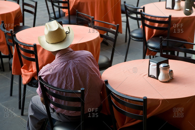 Man sitting at table at restaurant in Oaxaca
