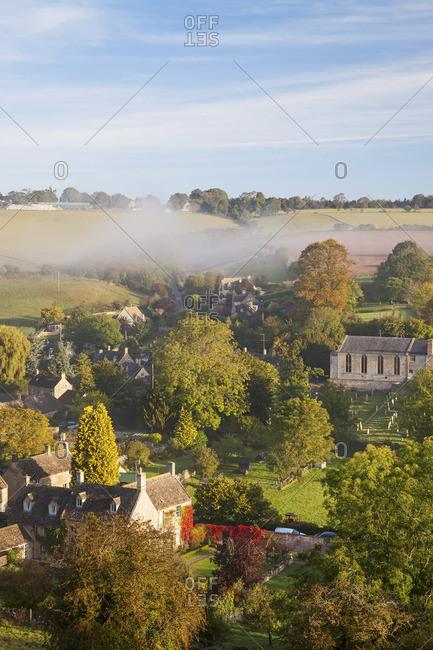 Naunton village and morning mist, UK