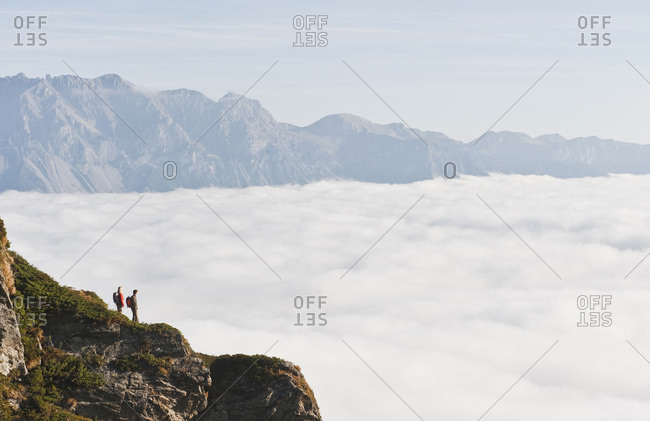 Austria, Steiermark, Reiteralm, Couple of hikers admiring view over clouds