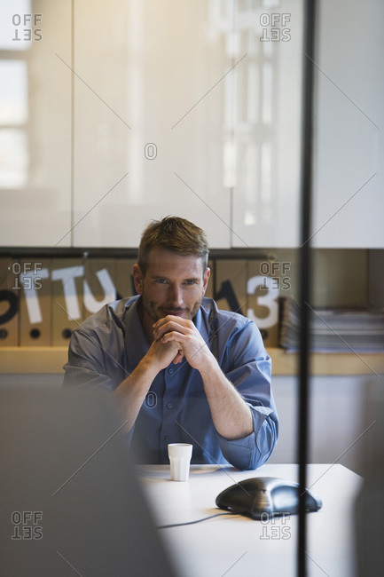 Young man in office waiting