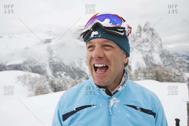 Italy, South Tyrol, Man in winter clothes, laughing, portrait