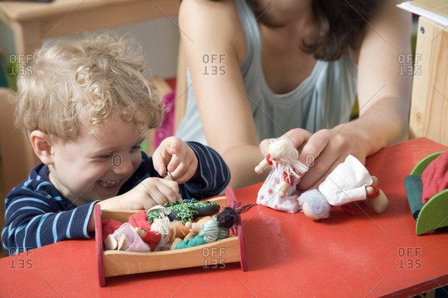 Germany, Berlin, Mother playing with son (3-4)