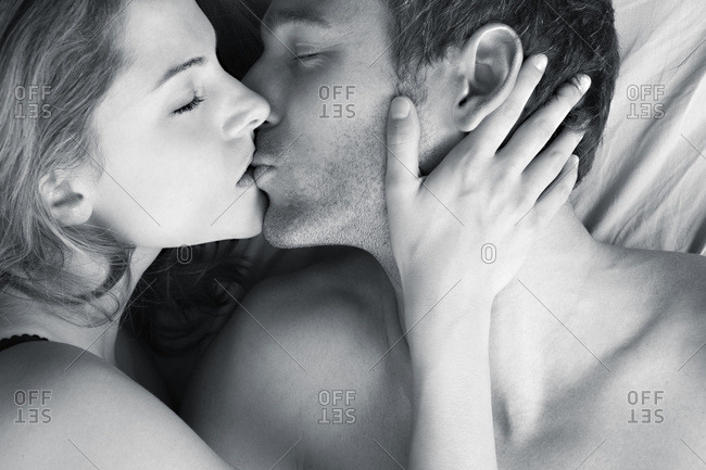 Young couple kissing, elevated view, close-up