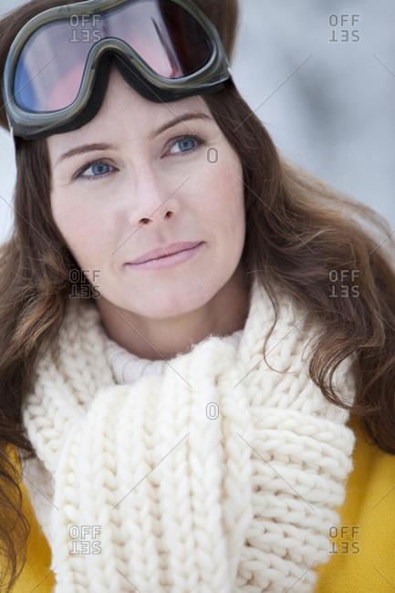 Germany, Bavaria, Woman with ski goggles, portrait