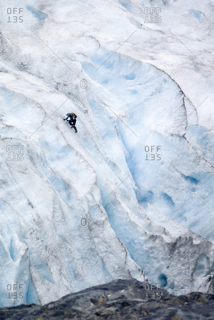 Ice climber on the blue ice of Exit Glacier
