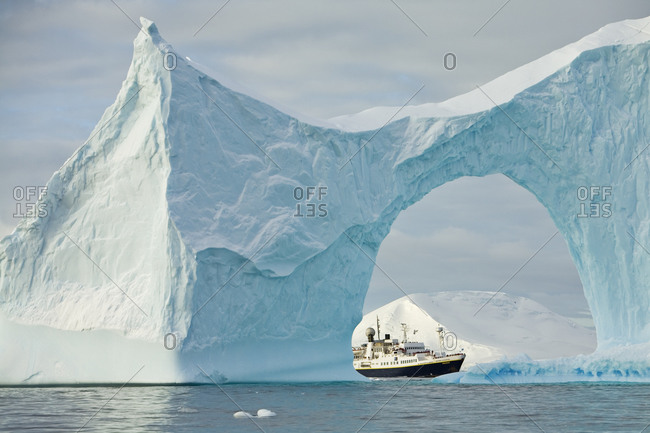 Iceberg with arch frame, National Geographic Endeavour, Antarctica