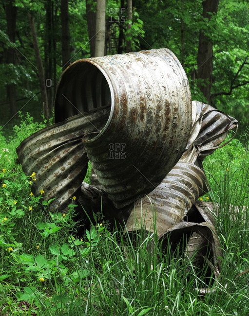 Dumped metal garbage in forest