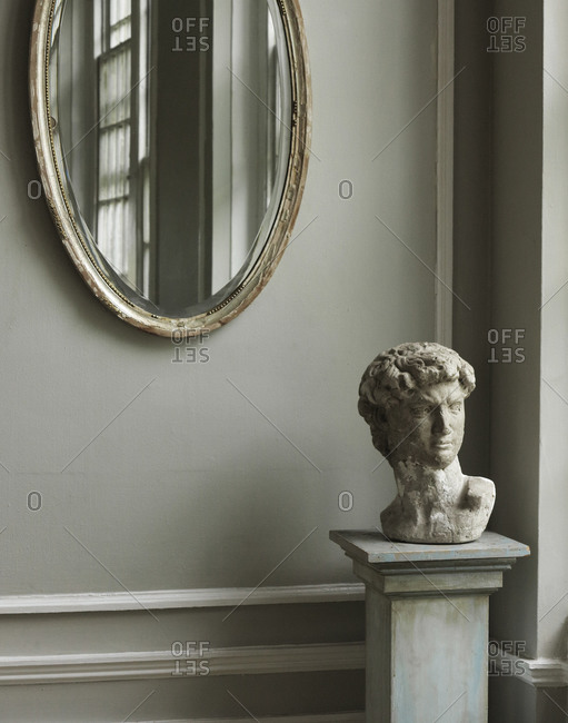 Still life with mirror and sculpture