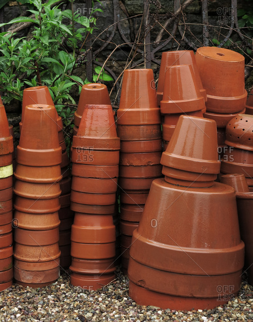 Stack of empty plant pots on the ground