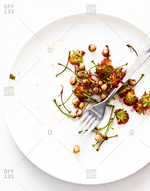 Cherry seeds and stems on plate