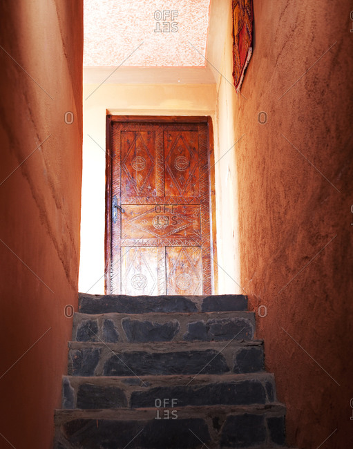 Stairs leading to wooden door