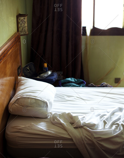 Close up of unmade bed