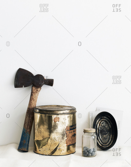Still life with cans and axe