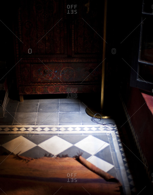 Checked tiles and carpet in sunlight