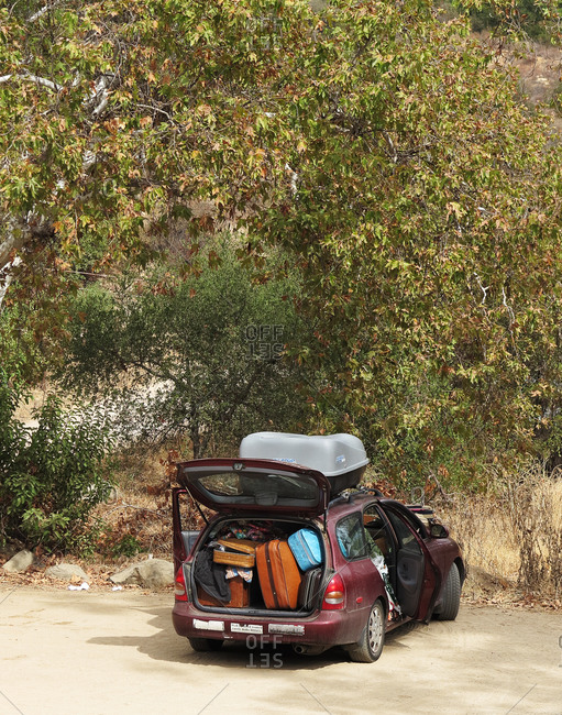 Car parking on byway full loaded with suitcases