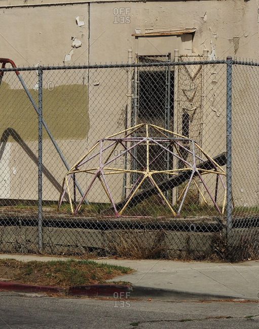 Abandoned playground with wired fence