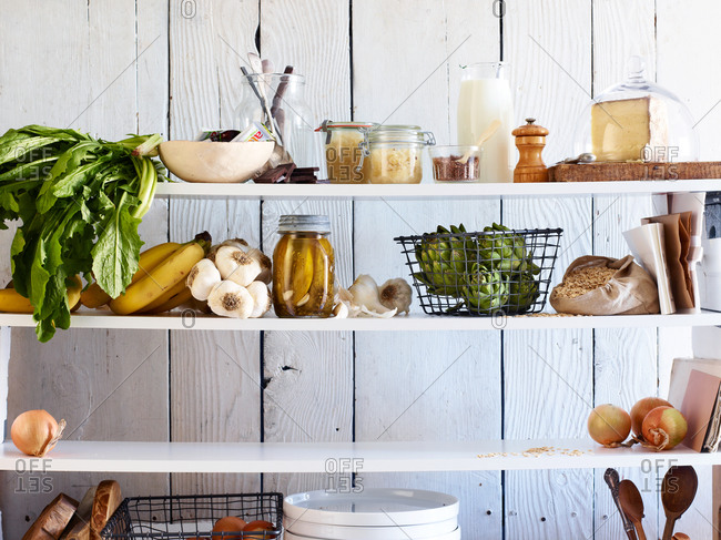 Shelves in a kitchen with ingredients