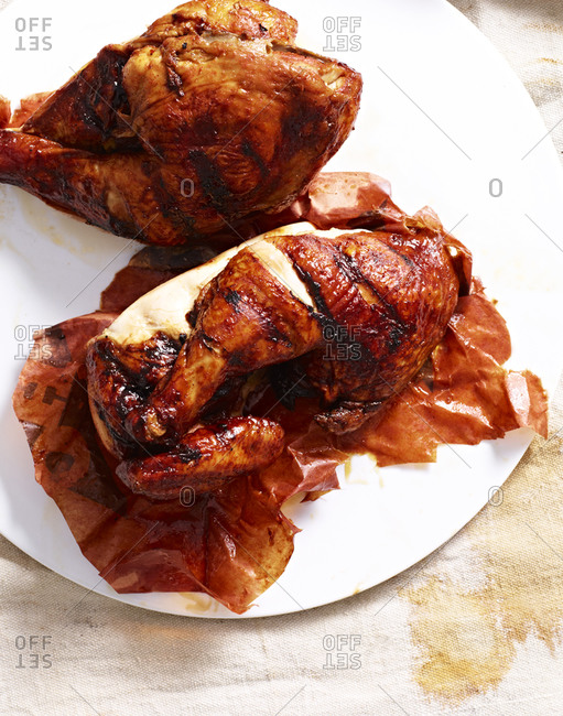 Two whole, roasted chickens
