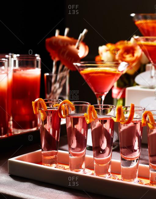 Shot glasses with liqueur and orange peel