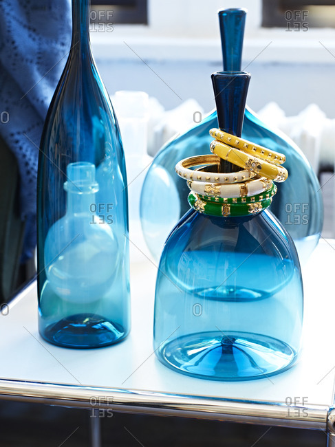 Blue bottles and bracelets on a table