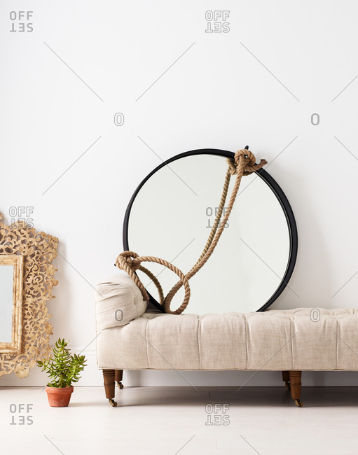 Settee and a round mirror