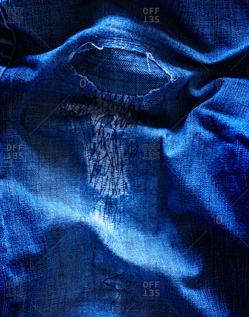 Close-up of ripped denim